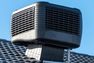 an evaporative cooler system on a roof