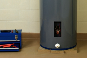 a water heater with a toolbox next to it