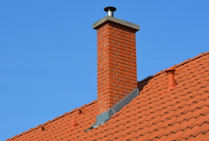 tile roof with chimney and metal flashing