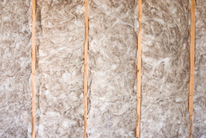 Insulation in the walls of a home.