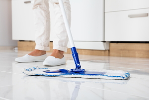 A mop cleaning a kitchen floor.