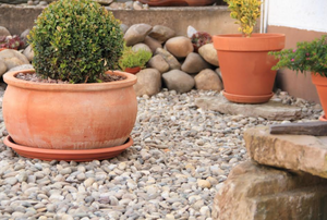 a rock garden with flower pots