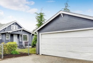 separate garage next to a house, both painted blue and white
