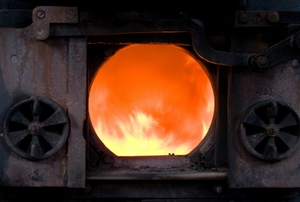 The firebox of a wood burning furnace.