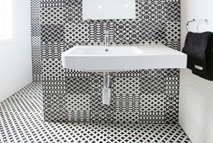 Black and white tiled bathroom.