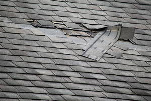 a few shingles ripped off of a roof