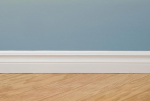 white molding against a blue wall