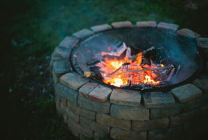 Metal fire pit surrounded by bricks