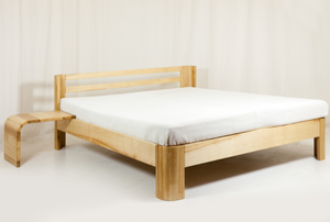wood bed frame with white mattress