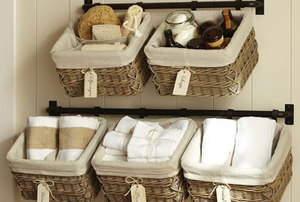 Baskets are hung on the wall to store small items.