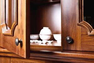 open wooden cabinet door with bowls inside