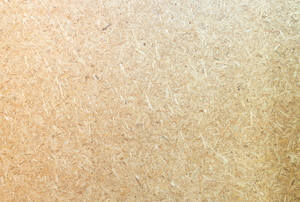 Close-up on the texture of a piece of particle board.