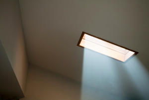 A small skylight lets natural light shine in from the ceiling.