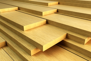 A pile of wooden planks, ready to be used.