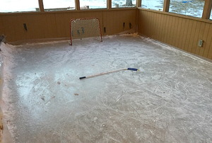 A hockey rink on an inclosed porch.