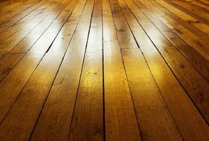 Light reflecting off hardwood flooring