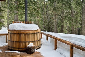 hot tub covered in winter snow