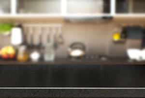 a dark Formica counter with kitchen accessories in the background