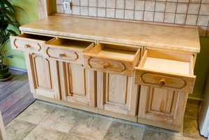 cabinet with a row of open drawers and cupboards below