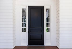 a black door surrounded by windows
