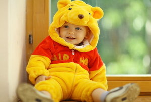 A kid in a Winnie the Pooh costume.