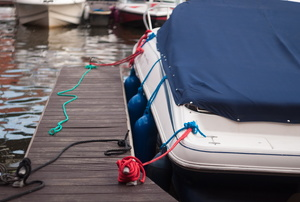 a boat tied to a dock