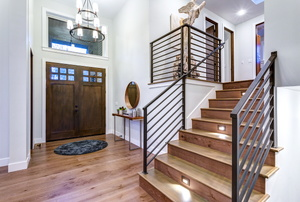 foyer with front door and staircase