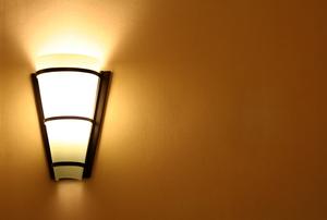 sconce illuminating wall