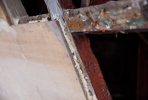 A piece of marine plywood nailed in place.