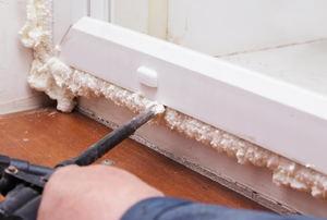applying spray foam insulation