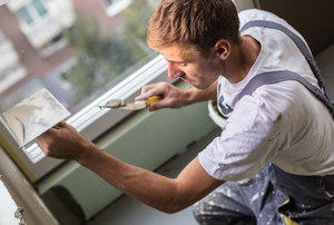 Man glazing a window