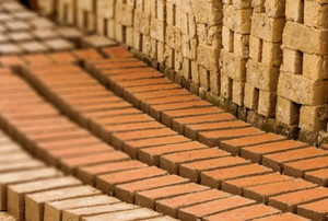 bricks laid out as part of a walkway under construction