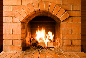 fire in a clean brick fireplace