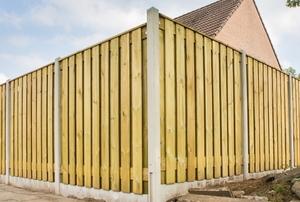 spaced board wood fence corner