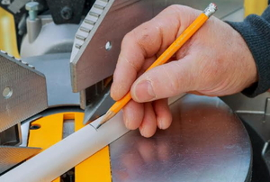 hand measuring an angle with a saw