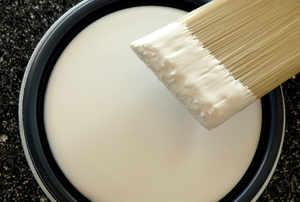 A brush in white paint.