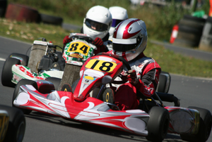 go karts side by side in a race