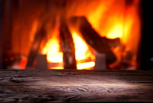 A warm, active fire in a fireplace.