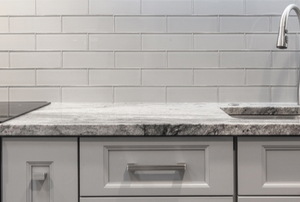 kitchen counter with tile backsplash
