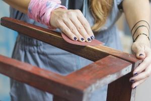 sanding wood chair