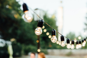 outdoor string lights in green yard