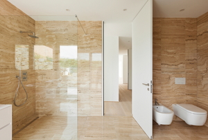 a sleek modern bathroom with smooth stone surfaces