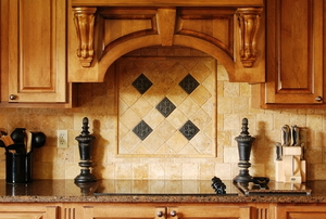 kitchen with custom wooden cabinets and natural toned tile backsplash