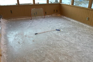 This Dad Turned His Enclosed Porch Into a Hockey Rink