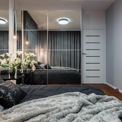 Mirrored Closet Doors In A Bedroom