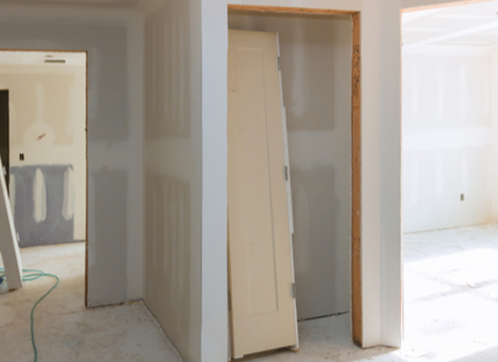 doorways in drywall hallway under construction