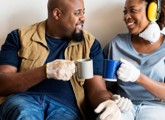 happy couple taking a coffee break during home improvement