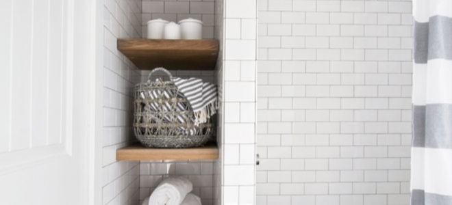 Small bathroom shelves with towels and baskets