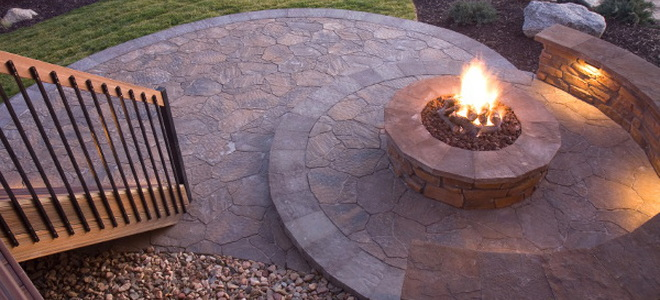 a firepit on a stone patio