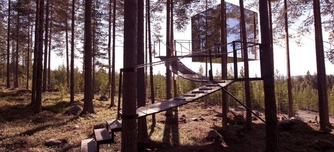 A glass-sided treehouse appearing to float in the trees